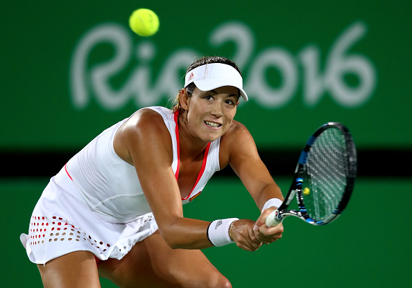 RIO DE JANEIRO, BRAZIL - AUGUST 07:  Garbine Muguruza of Spain plays a backhand against Andreea Mitu of Romania in their singles match on Day 2 of the Rio 2016 Olympic Games at the Olympic Tennis Centre on August 7, 2016 in Rio de Janeiro, Brazil.  (Photo by Clive Brunskill/Getty Images)