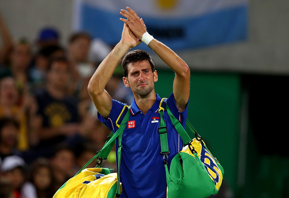 RIO DE JANEIRO, BRAZIL - AUGUST 07:  Novak Djokovic of Serbia shows his emotion as he waves to the crowd after his defeat against Juan Martin Del Potro of Argentina in their singles match on Day 2 of the Rio 2016 Olympic Games at the Olympic Tennis Centre on August 7, 2016 in Rio de Janeiro, Brazil.  (Photo by Clive Brunskill/Getty Images)