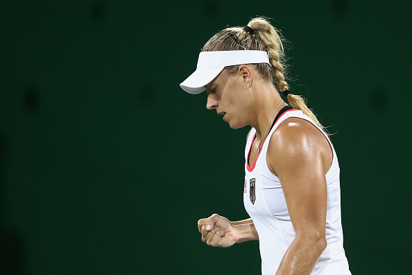 RIO DE JANEIRO, BRAZIL - AUGUST 09:  Angelique Kerber of Germany celebrates during the women's third round singles match against Samantha Stosur of Australia on Day 4 of the Rio 2016 Olympic Games at the Olympic Tennis Centre on August 9, 2016 in Rio de Janeiro, Brazil.  (Photo by Cameron Spencer/Getty Images)