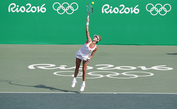 Spain's Garbine Muguruza competes during a women's singles third round match of tennis against Puerto Rico's Monica Puig at the 2016 Rio Olympic Games in Rio de Janeiro, Brazil, on Aug. 9, 2016. Monica Puig won 2-0./ CHINA OUT