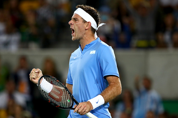 RIO DE JANEIRO, BRAZIL - AUGUST 07:  Juan Martin Del Potro reacts after winning a point against Novak Djokovic of Serbia in their singles match on Day 2 of the Rio 2016 Olympic Games at the Olympic Tennis Centre on August 7, 2016 in Rio de Janeiro, Brazil.  (Photo by Clive Brunskill/Getty Images)