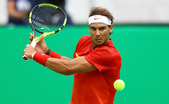 RIO DE JANEIRO, BRAZIL - AUGUST 11: Rafael Nadal of Spain in action during the men's singles third round match against Gilles Simon of France on Day 6 of the 2016 Rio Olympics at the Olympic Tennis Centre on August 11, 2016 in Rio de Janeiro, Brazil. (Photo by Amin Mohammad Jamali/Getty Images)