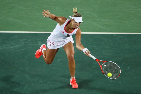 RIO DE JANEIRO, BRAZIL - AUGUST 12:  Angelique Kerber of Germany plays a forehand during the women's singles semifinal match against Madison Keys of the United States on Day 7 of the Rio 2016 Olympic Games at the Olympic Tennis Centre on August 12, 2016 in Rio de Janeiro, Brazil.  (Photo by Clive Brunskill/Getty Images)