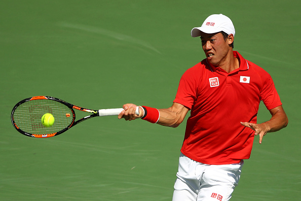 RIO DE JANEIRO, BRAZIL - AUGUST 13:  Kei Nishikori of Japan returns a shot against Andy Murray of Great Britain during the Men's Singles Semifinal Match on Day 8 of the Rio 2016 Olympic Games at the Olympic Tennis Centre on August 13, 2016 in Rio de Janeiro, Brazil.  (Photo by Clive Brunskill/Getty Images)