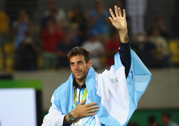 RIO DE JANEIRO, BRAZIL - AUGUST 14:  Silver medalist Juan Martin Del Potro of Argentina waves during the medal ceremony for the men's singles on Day 9 of the Rio 2016 Olympic Games at the Olympic Tennis Centre on August 14, 2016 in Rio de Janeiro, Brazil.  (Photo by Clive Brunskill/Getty Images)