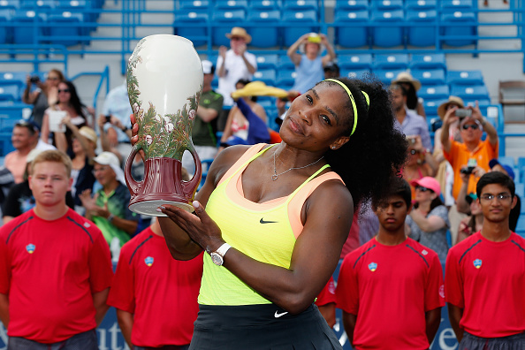 CINCINNATI, OH - AUGUST 23:  Serena Williams holds up the trophy after defeating Simona Halep of Romania to win the womens finals of the Western & Southern Open at the Linder Family Tennis Center on August 23, 2015 in Cincinnati, Ohio.  (Photo by Rob Carr/Getty Images)