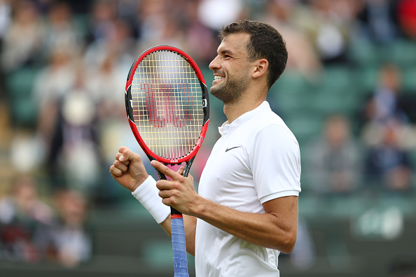 LONDON, ENGLAND - JUNE 30:  Grigor Dimitrov of Bulgaria celebrates victory during the Men's Singles second round match against Gilles Simon of France on day four of the Wimbledon Lawn Tennis Championships at the All England Lawn Tennis and Croquet Club on June 30, 2016 in London, England.  (Photo by Julian Finney/Getty Images)