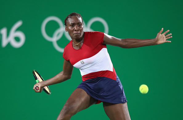 RIO DE JANEIRO, BRAZIL - AUGUST 06:  Venus Williams of USA in action against Kirsten Flipkens of Belgium in the women's first round on Day 1 of the Rio 2016 Olympic Games at the Olympic Tennis Centre on August 6, 2016 in Rio de Janeiro, Brazil.  (Photo by Julian Finney/Getty Images)