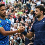 LONDON, ENGLAND - JUNE 15:  Grigor Dimitrov (R) of Bulgaria reacts at the net after defeating Feliciano Lopez of Spain during their Men's Singles Final on day seven of the Aegon Championships at Queens Club on June 15, 2014 in London, England.  (Photo by Jan Kruger/Getty Images)