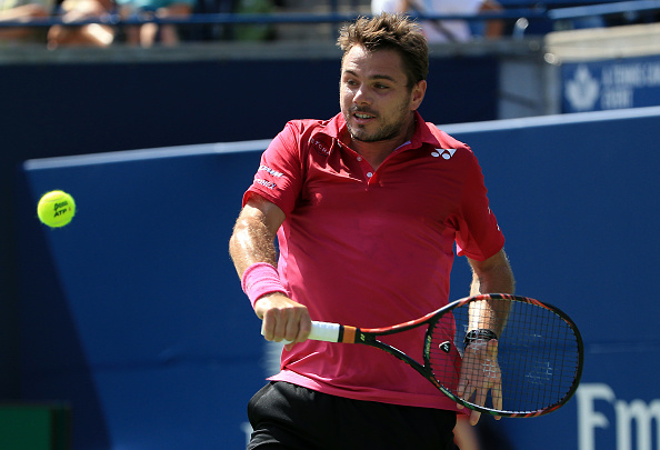 TORONTO, ON - JULY 30:  Stan Wawrinka of Switzerland hits a shot against Kei Nishikori of Japan during Day 6 of the Rogers Cup at the Aviva Centre on July 30, 2016 in Toronto, Ontario, Canada.  (Photo by Vaughn Ridley/Getty Images)