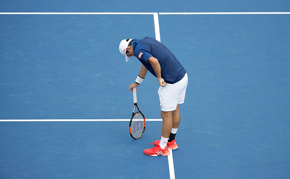 MASON, OH - AUGUST 18:  Kei Nishikori bends over after a long point during his third round match against Bernard Tomic  during day 6 of the Western & Southern Open at the Lindner Family Tennis Center  on August 18, 2016 in Mason, Ohio.  (Photo by Andy Lyons/Getty Images)