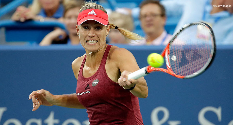 MASON, OH - AUGUST 17:  Angelique Kerber of Germany hits a return in  her 6-0, 7-5  victory over Kristina Mladenovic  in a second round match during day 5 of the Western & Southern Open at the Lindner Family Tennis Center   on August 17, 2016 in Mason, Ohio.  (Photo by Andy Lyons/Getty Images)