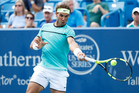 MASON, OH - AUGUST 17: Rafael Nadal of Spain hits a return to Pablo Cuevas of Uruguay on Day 5 of the Western & Southern Open at the Lindner Family Tennis Center on August 17, 2016 in Mason, Ohio. Nadal defeated Cuevas 6-1, 7-6. (Photo by Joe Robbins/Getty Images)