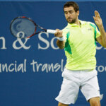 MASON, OH - AUGUST 18: Marin Cilic of Croatia hits a return to Tomas Berdych of the Czech Republic during a third round match on Day 6 of the Western & Southern Open at the Lindner Family Tennis Center on August 18, 2016 in Mason, Ohio. (Photo by Joe Robbins/Getty Images)