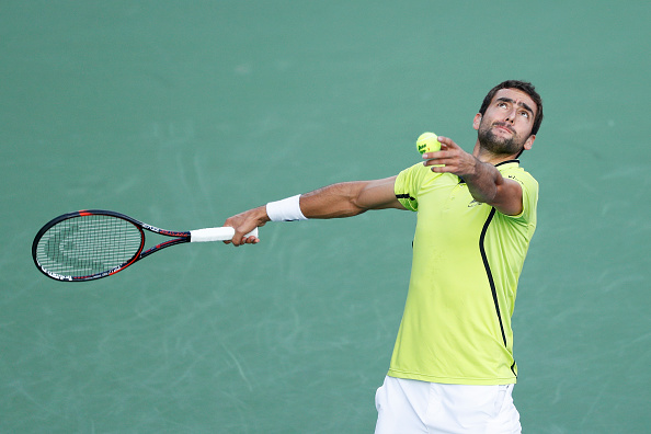 MASON, OH - AUGUST 15: Marin Cilic of Croatia serves to Viktor Troicki of Serbia on Day 3 of the Western & Southern Open at the Lindner Family Tennis Center on August 15, 2016 in Mason, Ohio. (Photo by Joe Robbins/Getty Images)