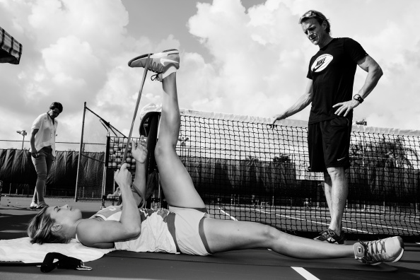 FORT LAUDERDALE, FL - JULY 30: Tennis superstar Eugenie Bouchard works out and practices during her daily routine on a Fort Lauderdale tennis court on July 30, 2014. (Photo by Benjamin Lowy/Getty Images)