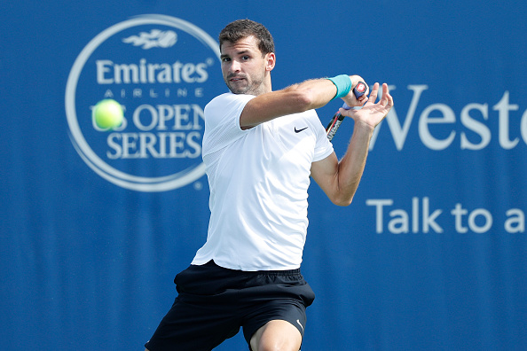 MASON, OH - AUGUST 18: Grigor Dimitrov of Bulgaria hits a return to Stan Wawrinka of Switzerland during round three play on Day 6 of the Western & Southern Open at the Lindner Family Tennis Center on August 18, 2016 in Mason, Ohio. (Photo by Joe Robbins/Getty Images)