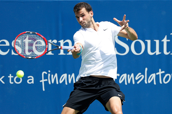 MASON, OH - AUGUST 18: Grigor Dimitrov of Bulgaria hits a return to Stan Wawrinka of Switzerland during round three play on Day 6 of the Western & Southern Open at the Lindner Family Tennis Center on August 18, 2016 in Mason, Ohio. Dimitrov upset Wawrinka 6-4, 6-4. (Photo by Joe Robbins/Getty Images)