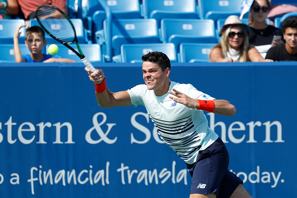 MASON, OH - AUGUST 17: Milos Raonic of Canada hits a return to John Isner of the United States on Day 5 of the Western & Southern Open at the Lindner Family Tennis Center on August 17, 2016 in Mason, Ohio. (Photo by Joe Robbins/Getty Images)