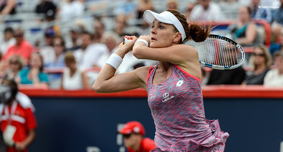 MONTREAL, ON - JULY 28:  Agnieszka Radwanska of Poland hits a return against Anastasia Pavlyuchenkova of Russia during day four of the Rogers Cup at Uniprix Stadium on July 28, 2016 in Montreal, Quebec, Canada.  Anastasia Pavlyuchenkova defeated Agnieszka Radwanska 4-6, 7-6, 1-6.  (Photo by Minas Panagiotakis/Getty Images)
