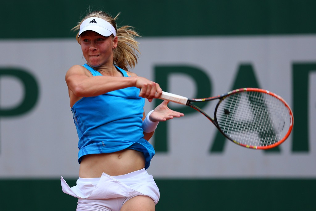 PARIS, FRANCE - MAY 25:  Johanna Larsson of Sweden returns a shot during her women's singles match against Maria Kirilenko of Russia on day one of the French Open at Roland Garros on May 25, 2014 in Paris, France.  (Photo by Clive Brunskill/Getty Images)