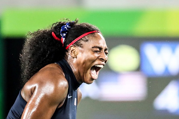 RIO DE JANEIRO, BRAZIL - AUGUST 09:  Serena Williams of the United States reacts during a match against Elina Svitolina of Ukraine in a Women's Singles Third Round match on Day 4 of the Rio 2016 Olympic Games at the Olympic Tennis Centre on August 9, 2016 in Rio de Janeiro, Brazil.  (Photo by William Volcov/Brazil Photo Press/LatinContent/Getty Images)