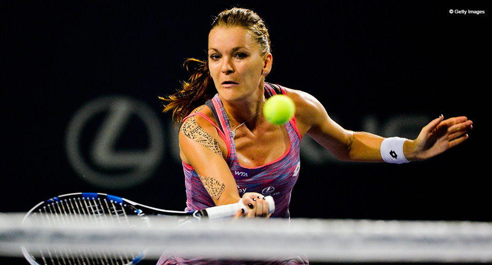 NEW HAVEN, CT - AUGUST 25:  Agnieszka Radwanska of Poland returns a shot to Kirsten Flipkens of Belgium on day 5 of the Connecticut Open at the Connecticut Tennis Center at Yale on August 25, 2016 in New Haven, Connecticut.  (Photo by Alex Goodlett/Getty Images)