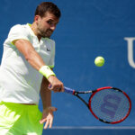 NEW YORK, NY - AUGUST 30:  Grigor Dimitrov of Bulgaria returns a shot to Inigo Cervantes of Spain during his first round Men's Singles match on Day Two of the 2016 US Open at the USTA Billie Jean King National Tennis Center on August 30, 2016 in the Flushing neighborhood of the Queens borough of New York City.  (Photo by Andy Lyons/Getty Images)