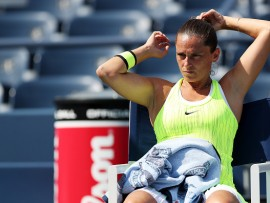 NEW YORK, NY - AUGUST 31:  Roberta Vinci of Italy cools off between games against Christina McHale of the United States during her second round Women's Singles match on Day Three of the 2016 US Open at the USTA Billie Jean King National Tennis Center on August 31, 2016 in the Flushing neighborhood of the Queens borough of New York City.  (Photo by Joe Scarnici/Getty Images)