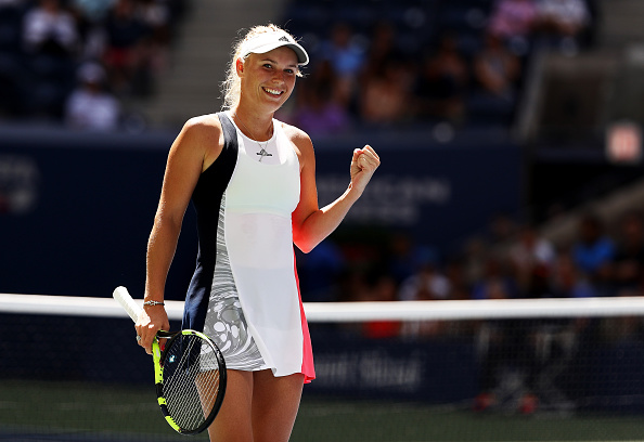 NEW YORK, NY - SEPTEMBER 02: Caroline Wozniacki of Denmark celebrates her win over Monica Niculescu of Romania during her third round Women's Singles match on Day Five of the 2016 US Open at the USTA Billie Jean King National Tennis Center on September 2, 2016 in the Flushing neighborhood of the Queens borough of New York City.  (Photo by Elsa/Getty Images)