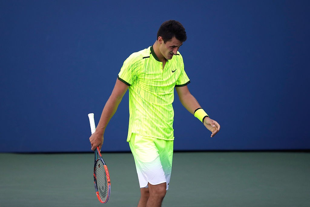 NEW YORK, NY - AUGUST 30:  Bernard Tomic of Australia reacts against Damir Dzumhur of Bosnia and Herzegovina during his first round Men's Singles match on Day Two of the 2016 US Open at the USTA Billie Jean King National Tennis Center on August 30, 2016 in the Flushing neighborhood of the Queens borough of New York City.  (Photo by Andy Lyons/Getty Images)