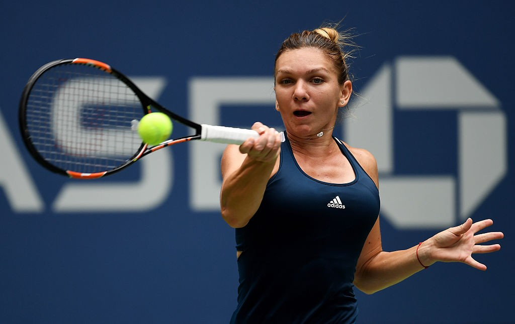 NEW YORK, NY - SEPTEMBER 03:  Simona Halep of Romania returns a shot to Timea Babos of Hungary during her third round Women's Singles match on Day Six of the 2016 US Open at the USTA Billie Jean King National Tennis Center on September 3, 2016 in the Flushing neighborhood of the Queens borough of New York City.  (Photo by Mike Hewitt/Getty Images)