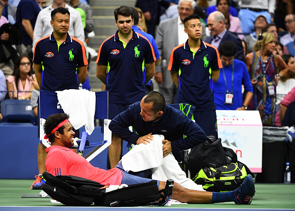 NEW YORK, NY - SEPTEMBER 06:  Jo-Wilfried Tsonga of France receives medical attention during his Men's Singles Quarterfinals match against Novak Djokovic of Serbia on Day Nine of the 2016 US Open at the USTA Billie Jean King National Tennis Center on September 6, 2016 in the Flushing neighborhood of the Queens borough of New York City.  (Photo by Alex Goodlett/Getty Images)