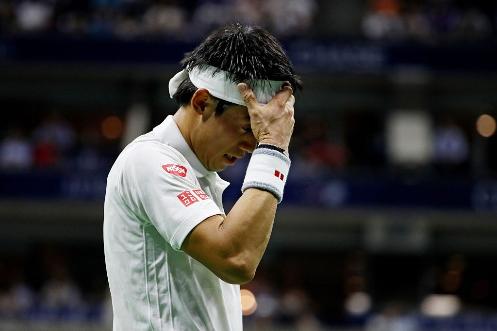 NEW YORK, NY - SEPTEMBER 09:  Kei Nishikori of Japan reacts against Stan Wawrinka of Switzerland during their Men's Singles Semifinal Match on Day Twelve of the 2016 US Open at the USTA Billie Jean King National Tennis Center on September 9, 2016 in the Flushing neighborhood of the Queens borough of New York City.  (Photo by Al Bello/Getty Images)