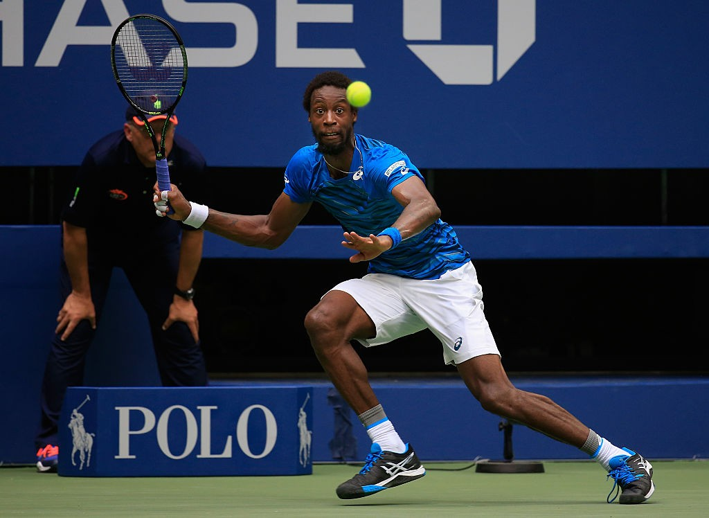 NEW YORK, NY - SEPTEMBER 09:  Gael Monfils of France returns a shot against Novak Djokovic of Serbia during their Men's Singles Semifinal Match on Day Twelve of the 2016 US Open at the USTA Billie Jean King National Tennis Center on September 9, 2016 in the Queens borough of New York City.  (Photo by Chris Trotman/Getty Images for USTA)