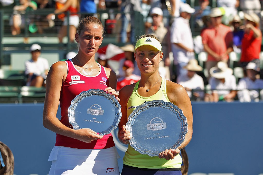STANFORD, CA - AUGUST 09:  Angelique Kerber (right) of Germany and Karolina Pliskova of the Czech Republic hold their trophies after Kerber beat Pliskova in the finals on Day 7 of the Bank of the West Classic at Stanford University Taube Family Tennis Stadium on August 9, 2015 in Stanford, California.  (Photo by Ezra Shaw/Getty Images)