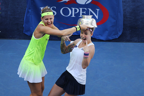2016 U.S. Open - Day 14  Bethanie Mattek-Sands, (right), of the United States and Lucie Safarova of the Czech Republic joke with the trophy after winning the Women's Doubles Final against Caroline Garcia and Kristina Mladenovic of France on Arthur Ashe Stadium on day fourteen of the 2016 US Open Tennis Tournament at the USTA Billie Jean King National Tennis Center on September 11, 2016 in Flushing, Queens, New York City.  (Photo by Tim Clayton/Corbis via Getty Images)