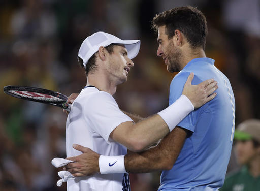 Andy Murray, of England, embraces Juan Martin del Potro, of Argentina, right, after winning the gold medal in men's singles at the 2016 Summer Olympics in Rio de Janeiro, Brazil, Sunday, Aug. 14, 2016. (AP Photo/Charles Krupa)