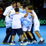 GLASGOW, SCOTLAND - SEPTEMBER 18:  Leonardo Mayer of Argentina celebrates with his team-mates, including Juan Martin del Potro and Federico Delbonis, after winning his singles match against Dan Evans of Great Britain during day three of the Davis Cup semi final between Great Britain and Argentina at Emirates Arena on September 18, 2016 in Glasgow, Scotland.  (Photo by Clive Brunskill/Getty Images)