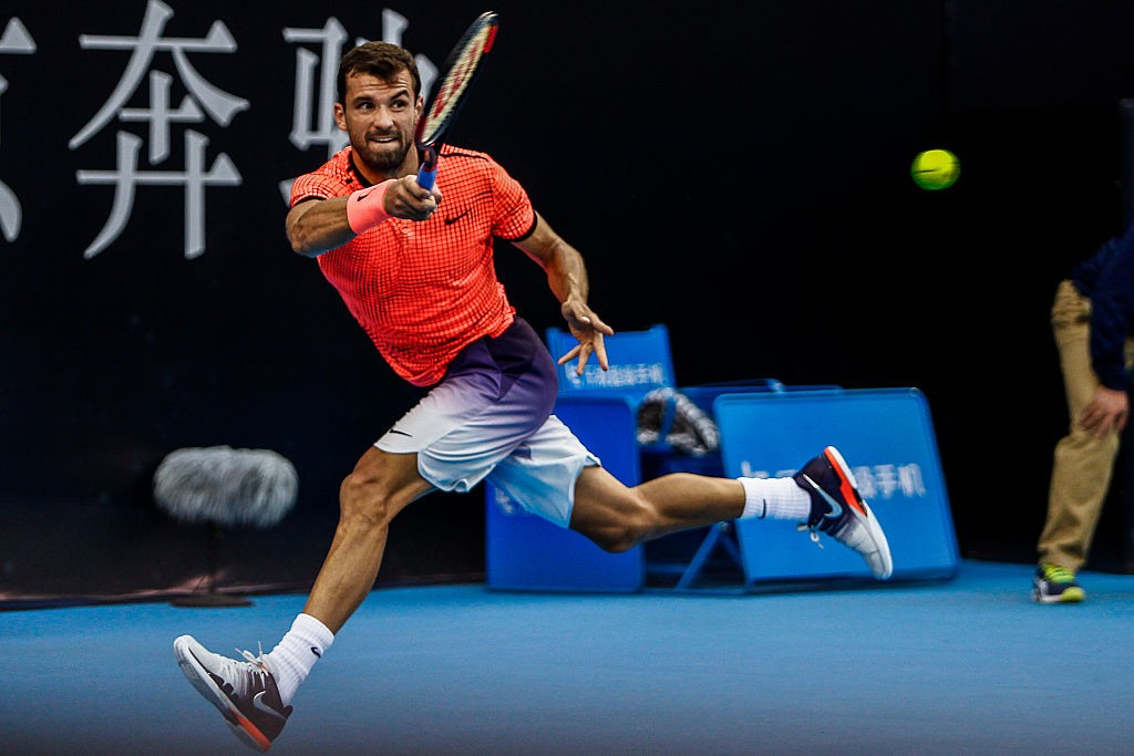 BEIJING, CHINA - OCTOBER 05:  Grigor Dimitrov of Bulgaria returns a shot against Steve Johnson of the United States during the Men's singles first round match on day five of the 2016 China Open at the China National Tennis Centre on October 5, 2016 in Beijing, China.  (Photo by VCG/VCG via Getty Images)