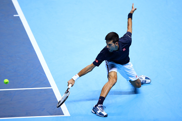 LONDON, ENGLAND - NOVEMBER 15:  Novak Djokovic of Serbia hits a backhand during his men's singles match against Novak Djokovic of Serbia on day three of the ATP World Tour Finals at O2 Arena on November 15, 2016 in London, England.  (Photo by Clive Brunskill/Getty Images)