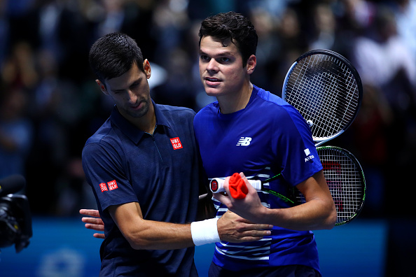 LONDON, ENGLAND - NOVEMBER 15:  Novak Djokovic of Serbia speaks with Milos Raonic of Canada at the net after their men's singles match on day three of the ATP World Tour Finals at O2 Arena on November 15, 2016 in London, England.  (Photo by Clive Brunskill/Getty Images)