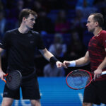 LONDON, ENGLAND - NOVEMBER 17:  Jamie Murray (L) of Great Britain and Bruno Soares of Brazil celebrate a point in their men's doubles match against Ivan Dodig of Croatia and Marcelo Melo of Brazil on day five of the ATP World Tour Finals at O2 Arena on November 17, 2016 in London, England.  (Photo by Clive Brunskill/Getty Images)