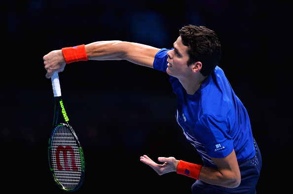 LONDON, ENGLAND - NOVEMBER 17:  Milos Raonic of Canada serves in his men's singles match against Dominic Thiem of Austria on day five of the ATP World Tour Finals at O2 Arena on November 17, 2016 in London, England.  (Photo by Justin Setterfield/Getty Images)