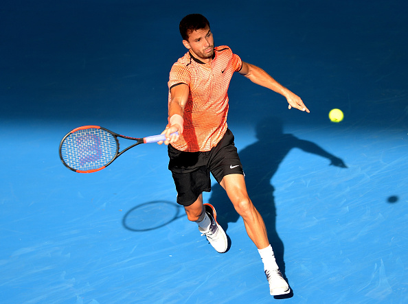 BRISBANE, AUSTRALIA - JANUARY 06:  Grigor Dimitrov of Bulgaria plays a forehand against Dominic Thiem of Austria on day six of the 2017 Brisbane International at Pat Rafter Arena on January 6, 2017 in Brisbane, Australia. (Photo by Bradley Kanaris/Getty Images)