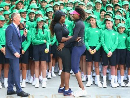 MELBOURNE, AUSTRALIA - JANUARY 10:  Serena Williams (L) arrives to the suprise of sister Venus Williams of the USA as Australian Open Tournament Director Craig Tiley introduces them to over 380 Australian Open ballkids for the annual welcome ceremony during a practice session ahead of the 2017 Australian Open at Melbourne Park on January 10, 2017 in Melbourne, Australia.  (Photo by Michael Dodge/Getty Images)