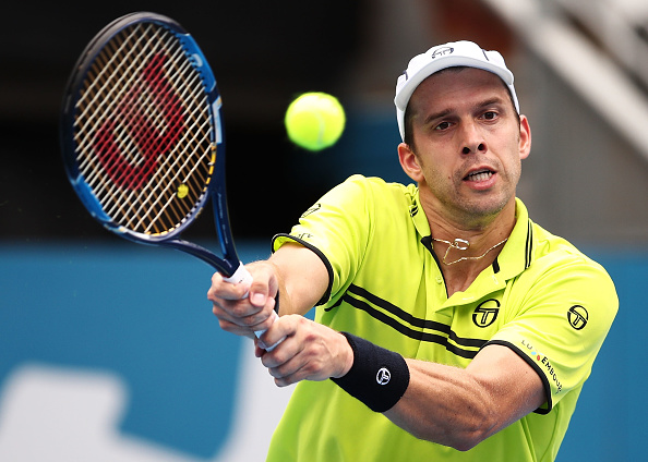 SYDNEY, AUSTRALIA - JANUARY 12:  Gilles Muller of Luxembourg plays a backhand in his quarter final match against Pablo Cuevas of Uruguay during day five of the 2017 Sydney International at Sydney Olympic Tennis Centre on January 12, 2017 in Sydney, Australia.  (Photo by Brendon Thorne/Getty Images)
