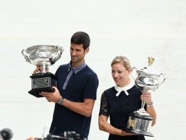 MELBOURNE, AUSTRALIA - JANUARY 13:  Defending champions Novak Djokovic of Serbia and Angelique Kerber of Germany carry the Australian Open trophies prior to the official draw ahead of the 2017 Australian Open at Melbourne Park on January 13, 2017 in Melbourne, Australia.  (Photo by Robert Prezioso/Getty Images)