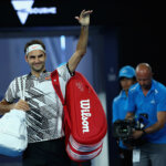 MELBOURNE, AUSTRALIA - JANUARY 16:  Roger Federer of Switzerland waves to the crowd as he leaves the court after victory in his first round match against Jurgen Melzer of Austria on day one of the 2017 Australian Open at Melbourne Park on January 16, 2017 in Melbourne, Australia.  (Photo by Clive Brunskill/Getty Images)