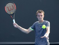 MELBOURNE, AUSTRALIA - JANUARY 16:  Alexander Bublik of Kazakhstan plays a forehand in his first round match against Lucas Pouille of France on day one of the 2017 Australian Open at Melbourne Park on January 16, 2017 in Melbourne, Australia.  (Photo by Pat Scala/Getty Images)